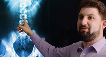 Dr. Ben Wyant, InMotion Pain Solutions, reviewing an x-ray.